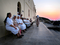 MALTA GOZO MARSALFORN 20JUL06 - Catholic nuns sit outside their retreat at Dar Madre Margherita on the outskirts of Marsalforn, Gozo...jre/Photo by Jiri Rezac..© Jiri Rezac 2006..Contact: +44 (0) 7050 110 417.Mobile:  +44 (0) 7801 337 683.Office:  +44 (0) 20 8968 9635..Email:   jiri@jirirezac.com.Web:    www.jirirezac.com