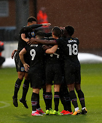Aston Villa's Scott Hogan (number 9) celebrates scoring his sides first goal with team-mates during the Carabao Cup, First Round match at the Weston Homes Community Stadium, Colchester.