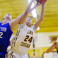 Tohatchi Cougar Brianna Denetso (24)grabs a rebound from Dexter Demon Madison Bogle (22) Friday at Tohatchi High School.
