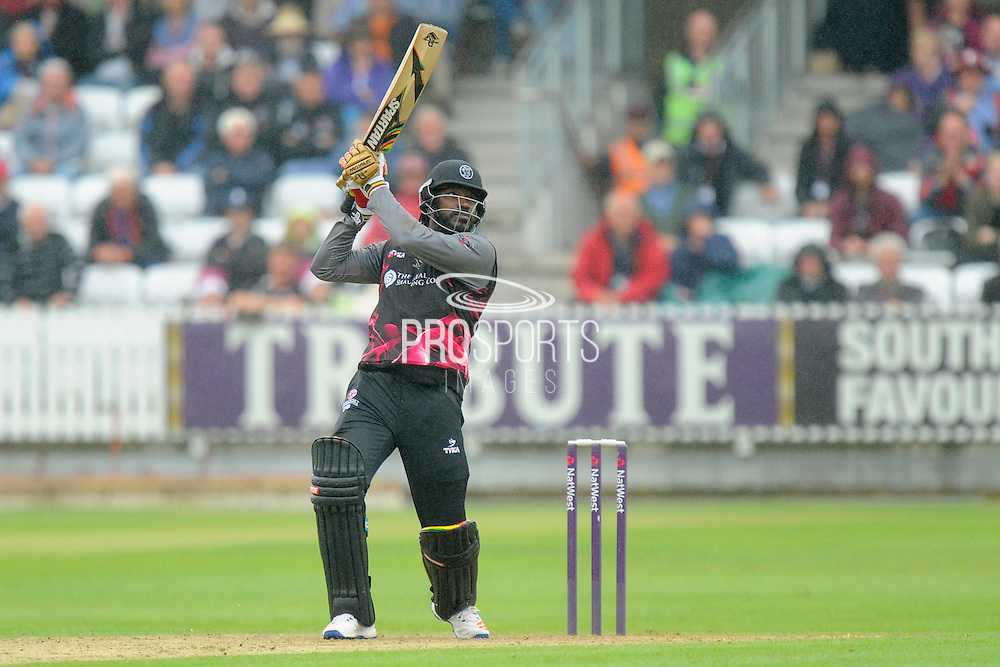 Somerset's Chris Gayle hitting a six during the NatWest T20 Blast South Group match between Somerset County Cricket Club and Hampshire County Cricket Club at the Cooper Associates County Ground, Taunton, United Kingdom on 19 June 2016. Photo by Graham Hunt.