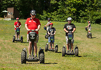 Mike Briggs gives his group an intro lesson on their Segways before hitting the trails at Gunstock Mountain Resort.  (Karen Bobotas/for the Laconia Daily Sun)