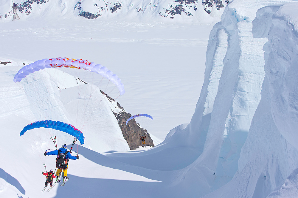 Jon Devore, Filippo Fabbi and Andy Farington fly through the middle of a glacier field while filming for the Unrideables in the Tordrillo Mountains near Anchorage, Alaska on April 29th, 2014.
