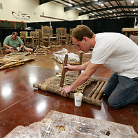 Thomas Wells | BUY at PHOTOS.DJOURNAL.COM<br /> Jeremy Martin of Tupelo helps assemble chairs for the Vermont Cedar Chair Company on Tuesday as the Tupelo Furniture Market is set to open on Wednesday.
