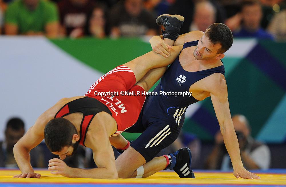 Commonwealth Games, Glasgow 2014<br /> SECC Wrestling 30.07.2014<br /> <br /> 61kg Bronze Medal Match-Viorel WINS<br /> <br /> Viorel Etko of Scotland (Blue) v Adam Vella(Red)  of Malta<br /> <br /> <br /> <br /> Neil Hanna Photography<br /> www.neilhannaphotography.co.uk<br /> 07702 246823