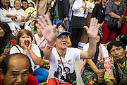 03 MARCH 2013 - BANGKOK, THAILAND: .Pheu Thai supporters boo their television set when it was announced that MR Sukhumbhand Paribatra, the incumbent running on the Democrat ticket, had won the election for Bangkok governor. Pongsapat Pongchareon, running on the Pheu Thai ticket, lost the Bangkok's Governor's race to MR Sukhumbhand Paribatra, the incumbent running on the Democrat ticket. Sukhumbhand won the race after scoring a record number of votes, more than 1.2 million to Pongsapat's 1 million. The results were seen as an upset even though Sukhumbhand was the incumbent because all of the pre-election polls and the exit polls conducted on election day showed Patsapong winning.     PHOTO BY JACK KURTZ