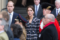 © Licensed to London News Pictures . 14/10/2016 . Manchester , UK . The Duke and Duchess of Cambridge sing the national anthem after laying a wreath during a service at the Cenotaph at Manchester Town Hall during a dedication service , on their visit in Manchester . Photo credit : Joel Goodman/LNP