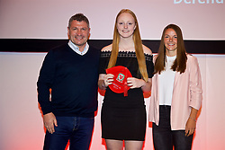 NEWPORT, WALES - Saturday, May 19, 2018: Grace Burke is presented with her Under-16's cap by Osian Roberts (left) and Lauren Dykes (right) during the Football Association of Wales Under-16's Caps Presentation at the Celtic Manor Resort. (Pic by David Rawcliffe/Propaganda)