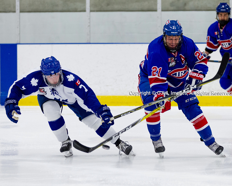 BURLINGTON, ON  - SEP 10,  2017: Ontario Junior Hockey League game between the Toronto Junior Canadiens and the Markham Royals, Douglas Carter #7 of the Markham Royals battles for the puck with Jason Pineo #21 of the Toronto Jr. Canadiens during the second period.<br /> (Photo by Christian Bender / OJHL Images)