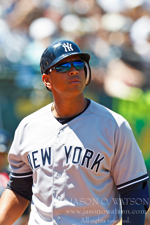 OAKLAND, CA - JULY 22: Alex Rodriguez #13 of the New York Yankees returns to the dugout after striking out against the Oakland Athletics during the fifth inning at O.co Coliseum on July 22, 2012 in Oakland, California.  The Oakland Athletics defeated the New York Yankees 5-4 in 12 innings. (Photo by Jason O. Watson/Getty Images) *** Local Caption *** Alex Rodriguez