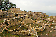 The gigantic fort of Kue?lap is located in the district of Tingo, province of Luya, department of Amazon, to a height of 3.000 meters on the level of the sea; in the top of a high mountain of the northen Andes in Peru.  The structure is almost 600 m in length and its walls rise up to 19 m in height.