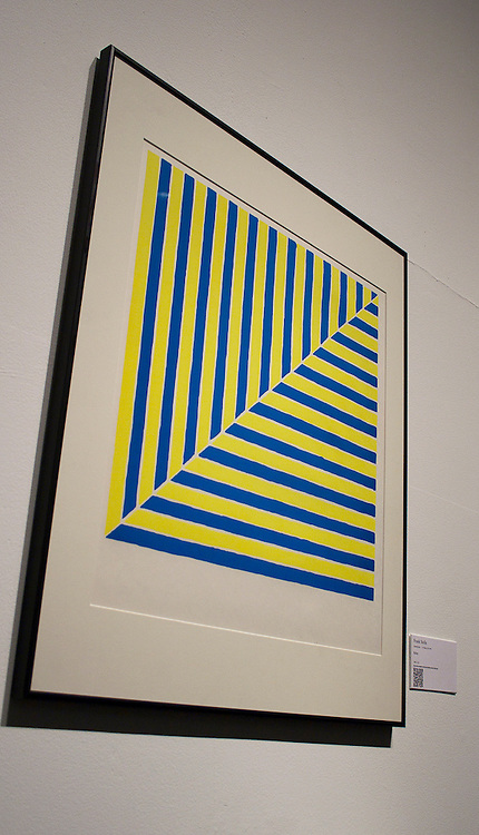 Frank Stella     <br /> American (Malden, Mass., 1936)<br /> Rabat<br /> 1982.001.052<br /> <br /> At the time he made this print, Frank Stella was a 28-year-old phenomenon whose Black Series paintings had been shown at the Museum of Modern Art in New York.  In that series, black stripes of equal width followed the rectangle of the canvas.  Stella claimed that the painting and canvas were inseparable components of an object.  The painting was a thing, not on a thing or about a thing.  This idea turned on its head Ad Reinhardt&rsquo;s goal in his black paintings.  Instead of radically simplifying painting to its transcendent experiential essence, Stella distilled painting into a solid, physical object.  Throughout his career, Stella has systematically complicated this proposition to the point where his objects became wildly colored and curvaceous sculptures.  &ldquo;Rabat,&rdquo; part of his Morocco series, was a first step in this direction.  In it, Stella adopts the traditional square tile shape and the blue and yellow colors of North African ceramics to his earlier patterns of the Black Series.   <br /> <br /> <br /> <br /> http://www.memphis.edu/amum/exhibitions/frank.stella.php