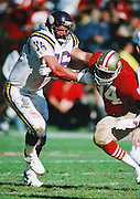 Minnesota Vikings offensive tackle Tim Irwin (76) attempts to block San Francisco 49ers defensive end Charles Haley (94) during the NFC Divisional Playoff NFL football game against the San Francisco 49ers on January 1, 1989 in San Francisco, CA. The 49ers won the game 34-9. ©Paul Anthony Spinelli