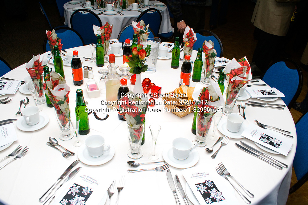 Lovely banquette table setting. Annual Swedish Christmas Julbord at the American Swedish Institute Minneapolis Minnesota MN USA