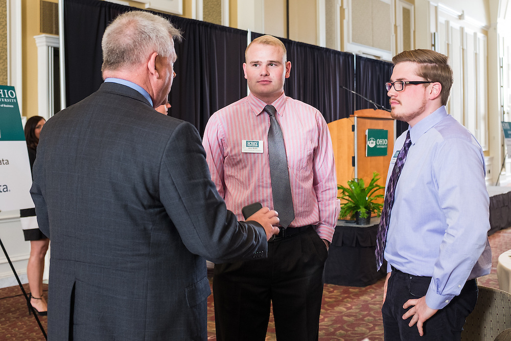 Commander Scott Waddle chats with students after his talk during Ohio University College of Business Schey Sales Centre Symposium on April 14, 2015.  Photo by Ohio University  /  Rob Hardin