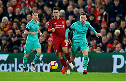 LIVERPOOL, ENGLAND - Saturday, December 29, 2018: Liverpool's Roberto Firmino (L) and Arsenal's Aaron Ramsey during the FA Premier League match between Liverpool FC and Arsenal FC at Anfield. (Pic by David Rawcliffe/Propaganda)