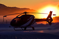 The sunrise and -36C ice fog surround this Horizon Helicopters Eurocopter EC-120B in a colourful glow.