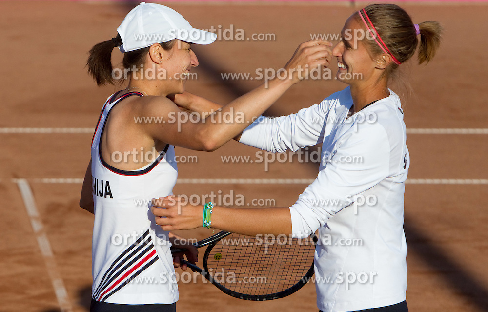 Katarina Srebotnik of Slovenia and Polona Hercog celebrate after winning the doubles  against Rebecca Marino and Sharon Fichman of Canada at the second day of the tennis Fed Cup match between Slovenia and Canada at Bonifika, on April 17, 2011 in Koper, Slovenia. Slovenia won 3-2 and stays in World Group II.  (Photo by Vid Ponikvar / Sportida)
