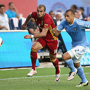 NEW YORK, NEW YORK - June 02: Yura Movsisyan #14 of Real Salt Lake is challenged by Jason Hernandez #2 of New York City FCin action during the NYCFC Vs Real Salt Lake regular season MLS game at Yankee Stadium on June 02, 2016 in New York City. (Photo by Tim Clayton/Corbis via Getty Images)