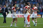 Japan players celebrate after the final whistle with  during the Rugby World Cup Pool B match between South Africa and Japan at the Community Stadium, Brighton and Hove, England on 19 September 2015. Photo by Phil Duncan.