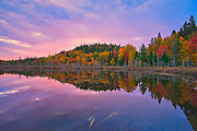 Autumn  colors at dawn reflected in Lac Boyer in the Laurentian Mountains. Great Lakes - St.  Lawrence Forest Region.<br />