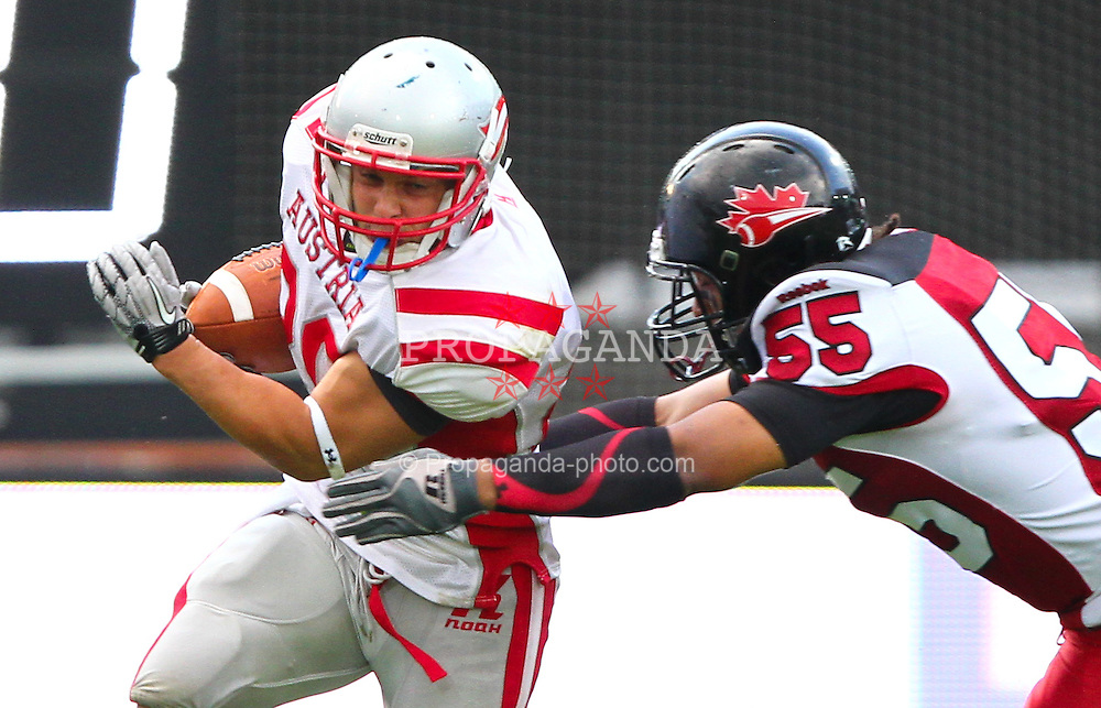11.07.2011, UPC Arena, Graz, AUT, American Football WM 2011, Group B, Canada (CAN) vs Austria (AUT), im Bild tackle from Peter Carrière (Canada, #55, LB) against Mario  Nerad (Austria, #20, RB)  // during the American Football World Championship 2011 Group B game, Canada vs Austria, at UPC Arena, Graz, 2011-07-11, EXPA Pictures © 2011, PhotoCredit: EXPA/ T. Haumer