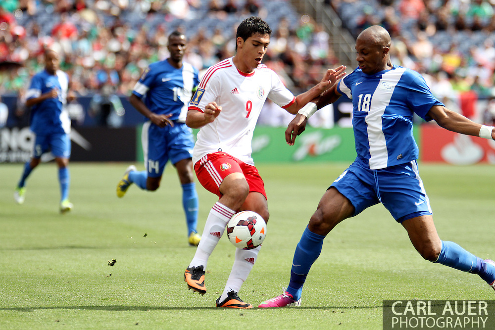 July 14 2013:  Mexico Forward Raul Jimenez (9) and Martinique Defender Gregory Arnolin (18) during the first half of the CONCACAF Gold Cup soccer match between Martinique and Mexico at Sports Authority Field in Denver, CO. USA.