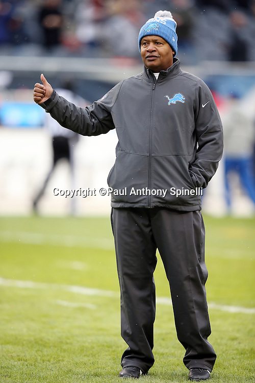 Detroit Lions head coach Jim Caldwell gives a thumbs up sign during pregame warmups before the NFL week 17 regular season football game against the Chicago Bears on Sunday, Jan. 3, 2016 in Chicago. The Lions won the game 24-20. (©Paul Anthony Spinelli)