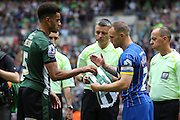 Barry Fuller (Captain) defender for AFC Wimbledon (2) and Plymouth Argyle defender Curtis Nelson (5) at the coin toss before the Sky Bet League 2 play off final match between AFC Wimbledon and Plymouth Argyle at Wembley Stadium, London, England on 30 May 2016. Photo by Stuart Butcher.