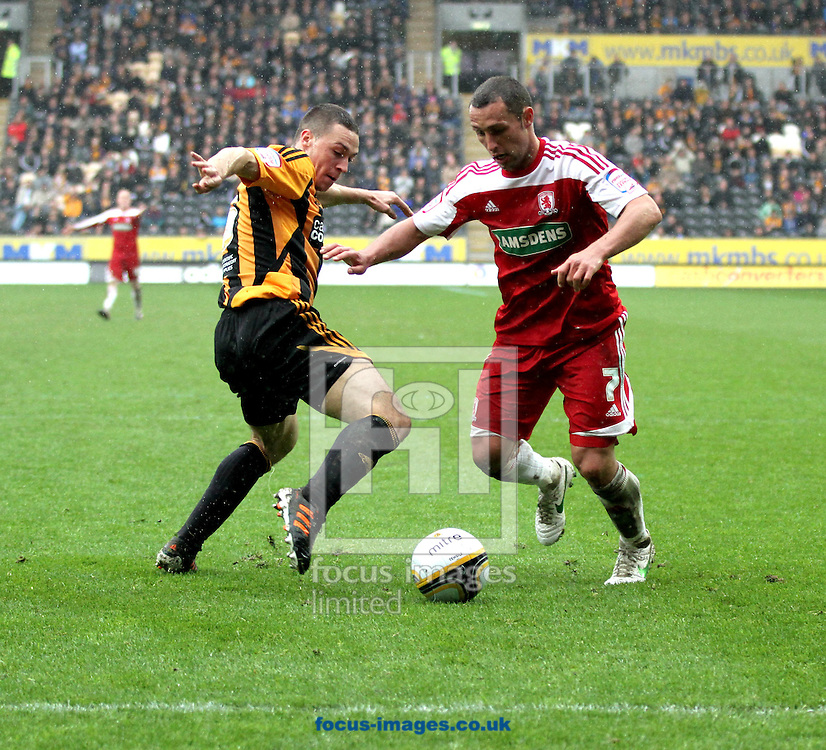 Picture by Richard Gould/Focus Images Ltd. 07710 761829.09/04/12.James Chester of Hull City and Scott McDonald of Middlesbrough during the Npower Championship match at KC Stadium, Hull.