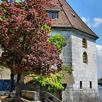 The Landhaus on Aare River in Solothurn, Switzerland <br /> The Landhaus, which is built along the banks of the Aare River in Solothurn, Switzerland, used to be a landing and warehouse for wine merchants.  After it was heavily destroyed by a fire in 1955, it was rebuilt and is now an event center and a café bar.