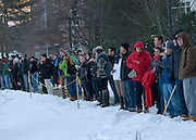Students watch the Puddle Jump on January 18, 2013. Several hundred students jumped into Lake Andrews on the campus of Bates College on a day that saw a high temperature of 16 degrees. The annual tradition is part of the college's Winter Carnival.