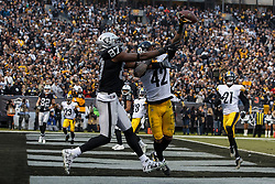 OAKLAND, CA - DECEMBER 09: Safety Morgan Burnett #42 of the Pittsburgh Steelers breaks up a pass intended for tight end Jared Cook #87 of the Oakland Raiders during the fourth quarter at the Oakland Coliseum on December 9, 2018 in Oakland, California. The Oakland Raiders defeated the Pittsburgh Steelers 24-21. (Photo by Jason O. Watson/Getty Images) *** Local Caption *** Morgan Burnett; Jared Cook
