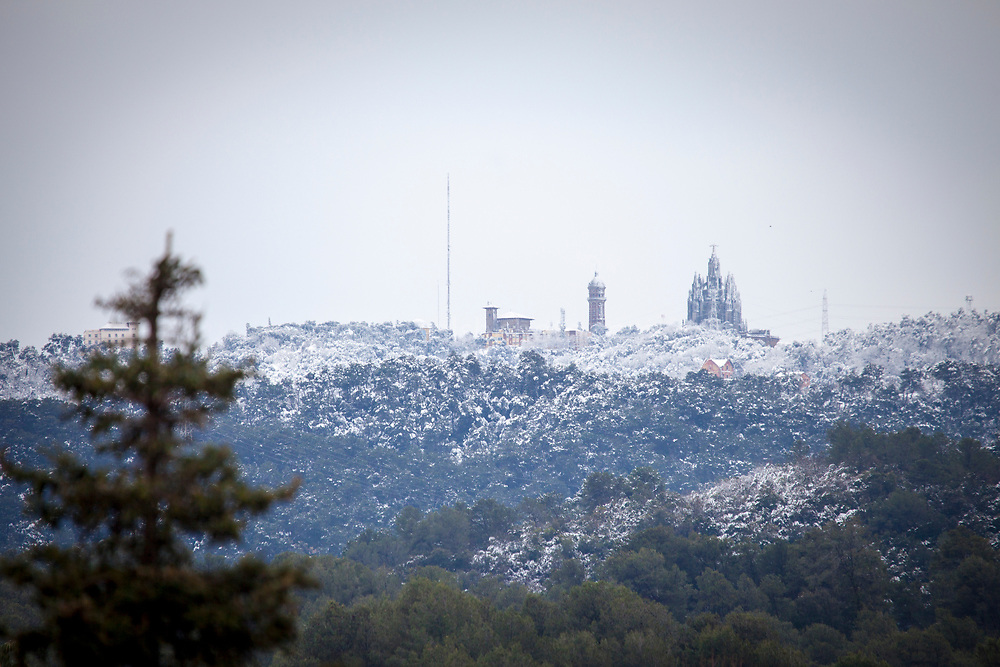 Snow on the basilica and amusement park Tibidabo, and surrounding Parc Collserola, Barcelona