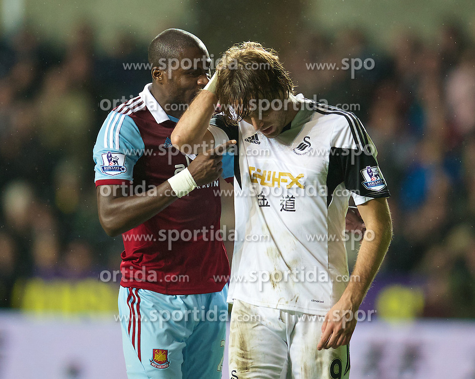 27.10.2013, Liberty Stadion, Swansea, ENG, Premier League, Swansea City vs West Ham United, 09. Runde, im Bild Swansea City's Miguel Perez Cuesta 'Michu' is accused using an elbow by West Ham United's Guy Demel // during the English Premier League 09th round match between Swansea City AFC and West Ham United at the Liberty Stadion in Swansea, Great Britain on 2013/10/27. EXPA Pictures &copy; 2013, PhotoCredit: EXPA/ Propagandaphoto/ David Rawcliffe<br /> <br /> *****ATTENTION - OUT of ENG, GBR*****