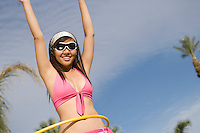 Portrait of Young Woman with Hula Hoop, Smiling