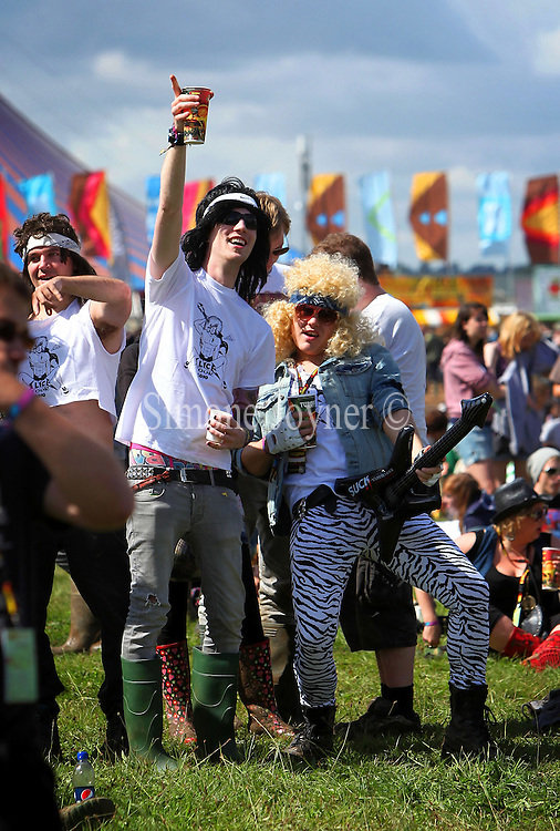Festival goers soak up the atmosphere during day one of Reading Festival on August 27, 2010 in Reading, England.  (Photo by Simone Joyner)
