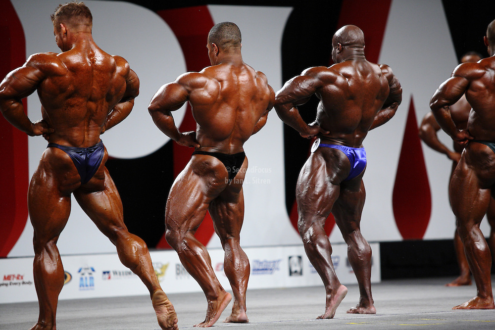 On stage at the pre-judging for the 2009 Olympia 202 competition in Las Vegas..James Flex Lewis, David Henry, Kevin English