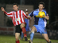 Photo: Pete Lorence.<br />Lincoln City v Wycombe Wanderers. Coca Cola League 2. 30/12/2006.<br />Lee Frecklington and Mike Williamson battle for the ball.