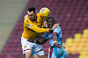 3rd November 2018, Fir Park, Motherwell, Scotland; Ladbrokes Premiership football, Motherwell versus Dundee; Genserix Kusunga of Dundee competes in the air with Ryan Bowman of Motherwell