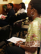 Carefully taking notes, Ayanna Jordan listens to a presentation on investing given by a Bank One investment banker Saturday afternoon at the 9th Mind, Body and Soul Women's Conference.  Mothers learned it is never too late to start saving while daughters and sons learned it is never too early.