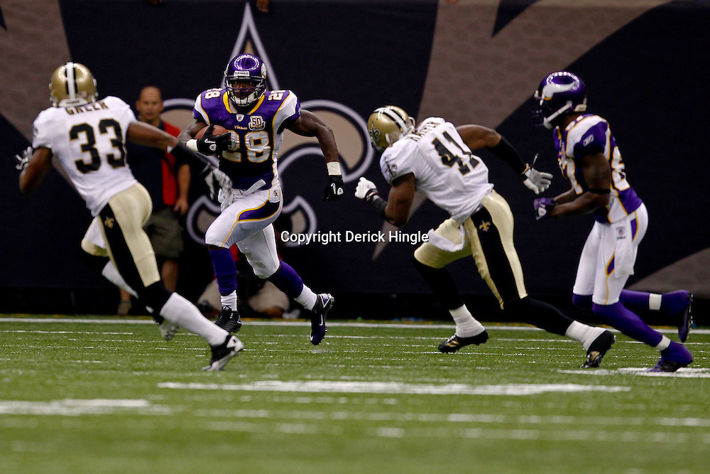 September 9, 2010; New Orleans, LA, USA; Minnesota Vikings running back Adrian Peterson (28) is pursued by New Orleans Saints safety Roman Harper (41) and cornerback Jabari Greer (33) during the NFL Kickoff season opener at the Louisiana Superdome. The New Orleans Saints defeated the Minnesota Vikings 14-9.  Mandatory Credit: Derick E. Hingle