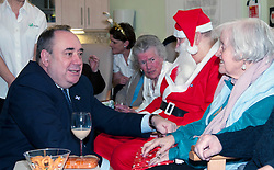 First Minister Alex Salmond, accompanied by Santa Clause (Arthur Martin), visited the Dean Club in Stiockbridge Edinburgh today to distribute Christmas presenets to the residents. The First Minister had a long chat with Rena Awramenko from Linlithgow. (c) GER HARLEY | StockPix.eu