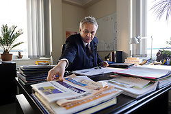 Manfred Bergmann, the European Commission's Directorate General for Taxation and Customs Union, works in his office, on Monday, Feb. 6, 2012, in Brussels. (Photo © Jock Fistick)