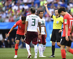 ROSTOV-ON-DON, June 23, 2018  The referee gives a yellow card to Jung Wooyoung (1st L) of South Korea during the 2018 FIFA World Cup Group F match between South Korea and Mexico in Rostov-on-Don, Russia, June 23, 2018. Mexico won 2-1. (Credit Image: © Chen Yichen/Xinhua via ZUMA Wire)