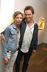 Actor DOMINIC WEST and SASHA SMITH-BINGHAM at a private view of artist Damian Elwes work 'Artists Studios' held at Scream, 34 Bruton Street, London W1 on 29th June 2006.<br />
