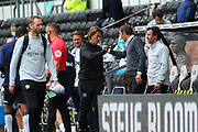 Phillip Cocu manager of Derby County & Thomas Frank manager of Brentford  fist bump during the EFL Sky Bet Championship match between Derby County and Brentford at the Pride Park, Derby, England on 11 July 2020.