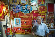 Old Town. Shop selling flags, banners and portraits of Marx, Lenin and uncle Ho.