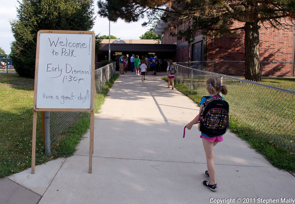 A student walks by a sign on the first day of school at Polk Elementary School, 1500 B Avenue NE, in Cedar Rapids on Thursday morning, July 21, 2011.