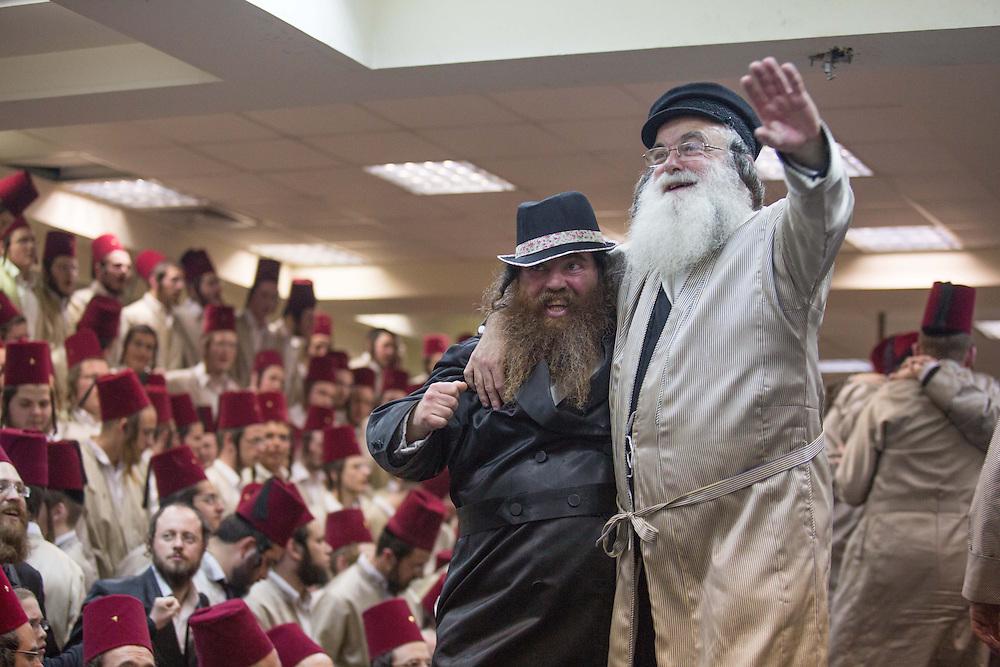 Ultra-orthodox jews dressed in costumes dance at the Matmidim Hasidic dynasty synagogue, during Purim tish. Jerusalem, Israel, 25 February 2013. Photo by Oren Nahshon.