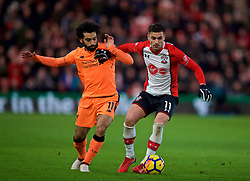 SOUTHAMPTON, ENGLAND - Sunday, February 11, 2018: Liverpool's Mohamed Salah and Southampton's Dusan Tadic during the FA Premier League match between Southampton FC and Liverpool FC at St. Mary's Stadium. (Pic by David Rawcliffe/Propaganda)
